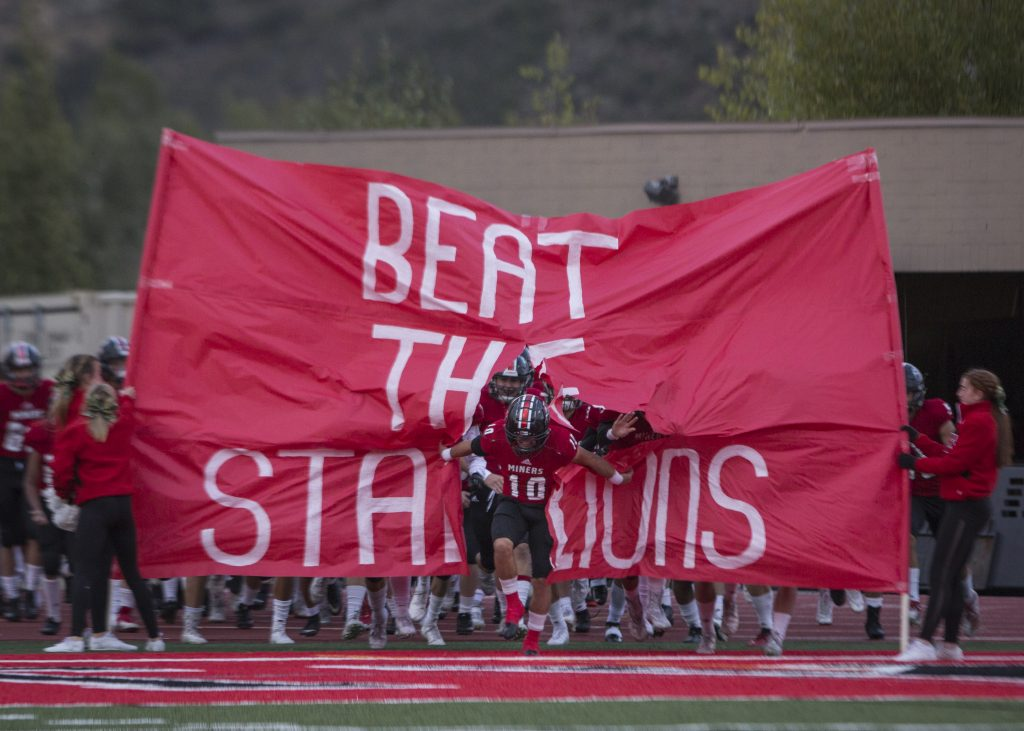 Miners thrash region rival Stansbury in 38-14 homecoming victory, remain undefeated